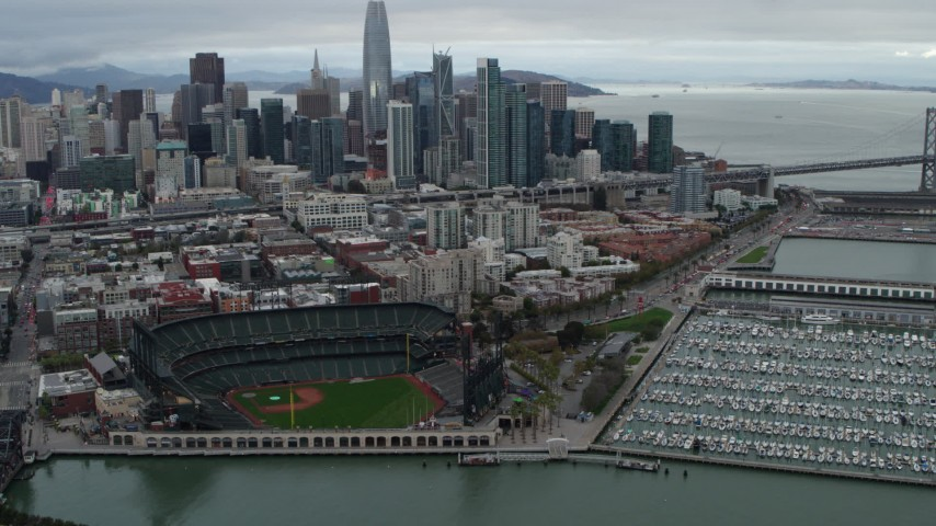5.7K stock footage aerial video flying away from AT&T Park, with city skyline in background, Downtown San Francisco, California Aerial Stock Footage | PP0002_000017