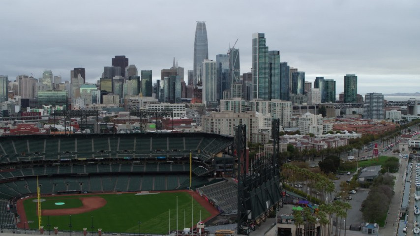 5.7K stock footage aerial video descend near AT&T Park and tilt to reveal city skyline in background, Downtown San Francisco, California Aerial Stock Footage | PP0002_000020