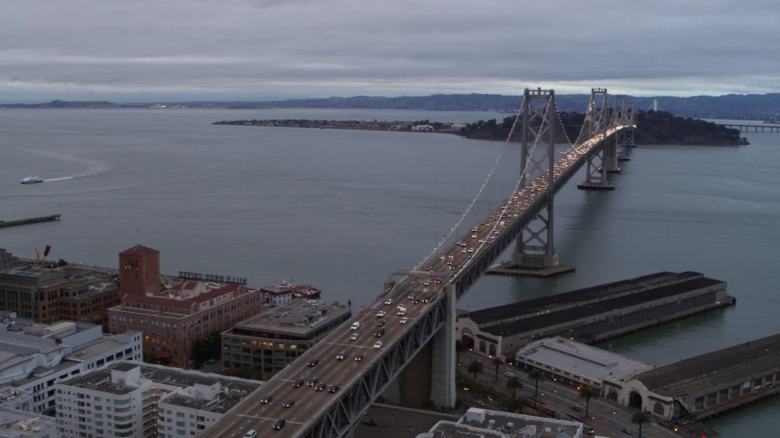 5.7K stock footage aerial video pan from Bay Bridge to reveal skyscrapers in South of Market and Downtown San Francisco, California Aerial Stock Footage | PP0002_000021