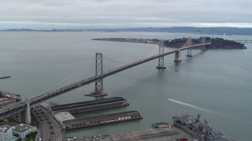 5.7K stock footage aerial video stationary view of the Bay Bridge, pan across the bay, San Francisco, California Aerial Stock Footage | PP0002_000032