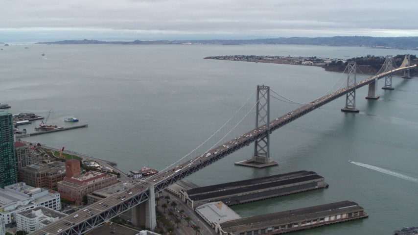 5.7K stock footage aerial video pan from the Bay Bridge, reveal South of Market skyscrapers, Downtown San Francisco, California Aerial Stock Footage | PP0002_000033