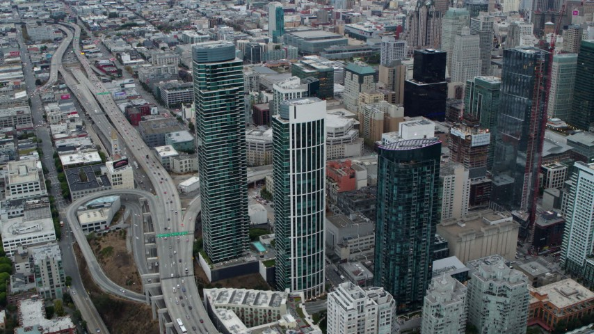 5.7K stock footage aerial video tilt from skyscrapers to bird's eye of traffic on Bay Bridge, Downtown San Francisco, California Aerial Stock Footage | PP0002_000043
