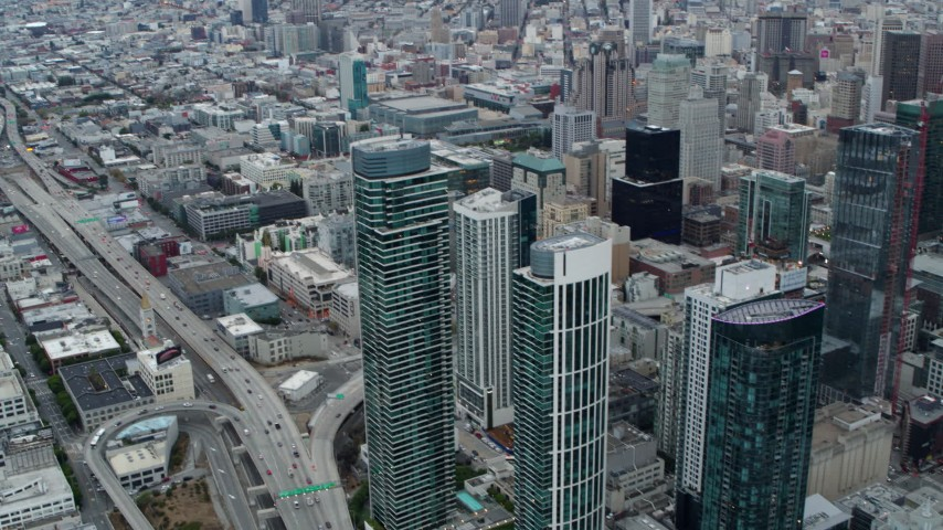 5.7K stock footage aerial video tilt from Bay Bridge to reveal skyscrapers and the expanse of the city, Downtown San Francisco, California Aerial Stock Footage   PP0002_000044
