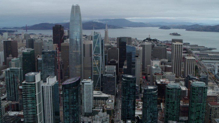 5.7K stock footage aerial video pan across tall skyscrapers to reveal the Bay Bridge, Downtown San Francisco, California Aerial Stock Footage | PP0002_000046