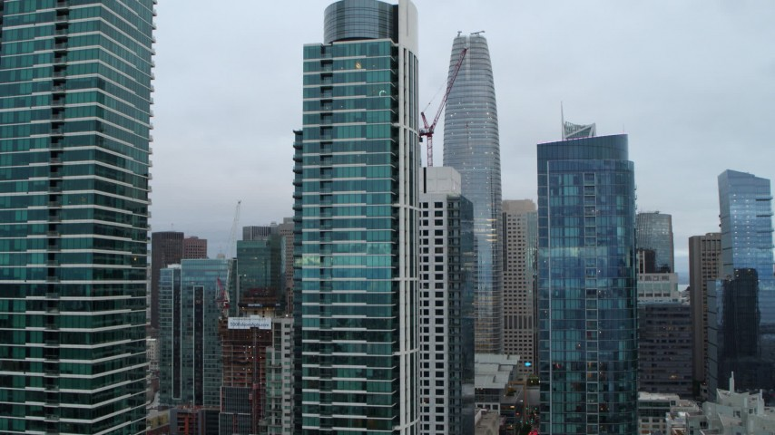5.7K stock footage aerial video descend by skyscrapers to reveal the Bay Bridge, Downtown San Francisco, California Aerial Stock Footage PP0002_000047 | Axiom Images