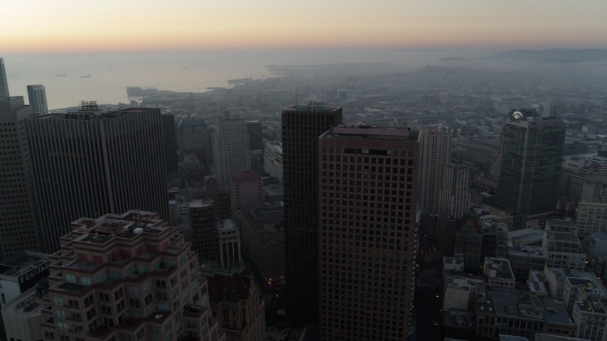 5.7K stock footage aerial video ascend and pan across skyscrapers at sunrise in Downtown San Francisco, California Aerial Stock Footage | PP0002_000049