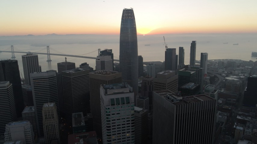 5.7K stock footage aerial video pan across Salesforce Tower and skyscrapers at sunrise in Downtown San Francisco, California Aerial Stock Footage | PP0002_000051