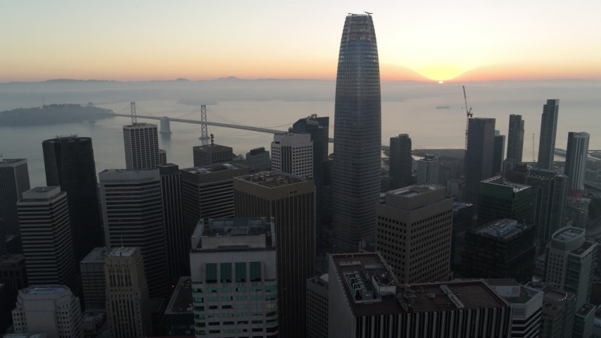 5.7K stock footage aerial video flying by Salesforce Tower and skyscrapers at sunrise in Downtown San Francisco, California Aerial Stock Footage | PP0002_000052