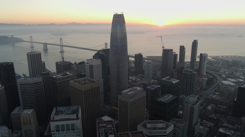 5.7K stock footage aerial video fly away from Salesforce Tower and skyscrapers at sunrise in Downtown San Francisco, California Aerial Stock Footage | PP0002_000056