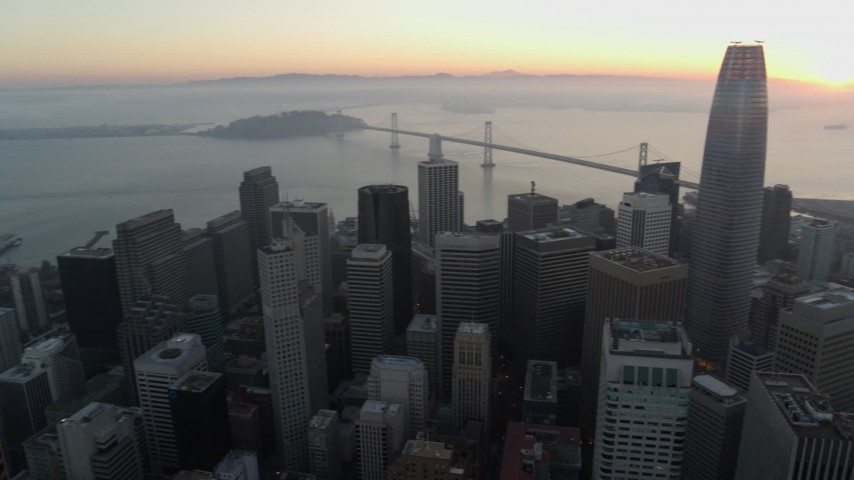 5.7K stock footage aerial video pan from Salesforce Tower to Coit Tower at sunrise in Downtown San Francisco, California Aerial Stock Footage | PP0002_000058
