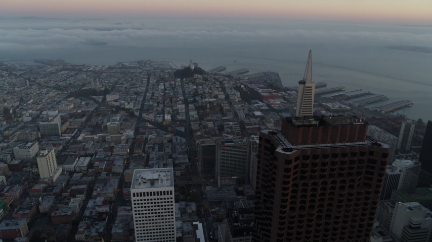 5.7K stock footage aerial video of Coit Tower and top of Transamerica Pyramid at sunrise in North Beach, San Francisco, California Aerial Stock Footage | PP0002_000059