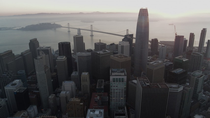 5.7K stock footage aerial video of Salesforce Tower at sunrise near Bay Bridge in Downtown San Francisco, California Aerial Stock Footage | PP0002_000061