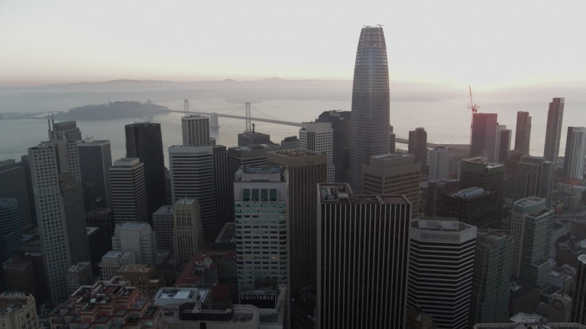 5.7K stock footage aerial video of Salesforce Tower at sunrise near Bay Bridge during descent in Downtown San Francisco, California Aerial Stock Footage | PP0002_000062