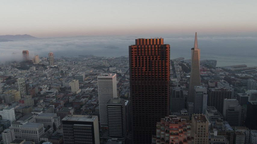 5.7K stock footage aerial video of fog over the bay behind city skyscrapers in Downtown San Francisco, California Aerial Stock Footage | PP0002_000071
