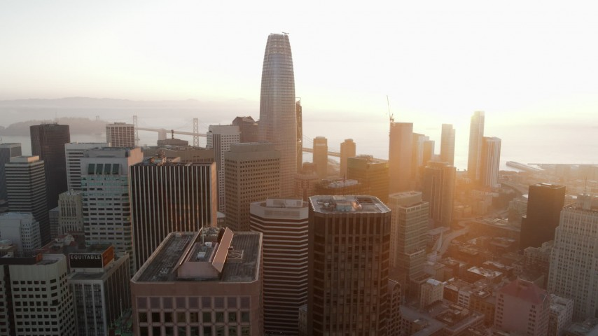 5.7K aerial video pan from fog over Civic Center, across South of Market, reveal Salesforce Tower at sunrise, Downtown San Francisco, California Aerial Stock Footage | PP0002_000076
