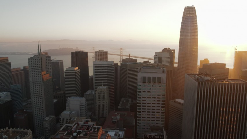 5.7K stock footage aerial video pan from Salesforce Tower to reveal skyscraper at sunrise, Downtown San Francisco, California Aerial Stock Footage | PP0002_000079
