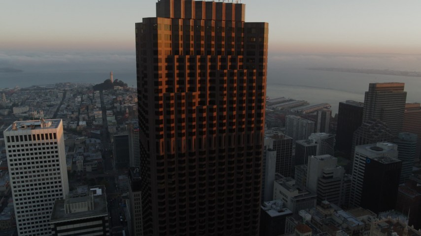 5.7K stock footage aerial video descend and pan across skyscrapers at sunrise, Downtown San Francisco, California Aerial Stock Footage | PP0002_000080