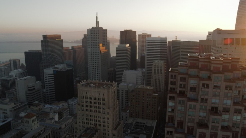 5.7K stock footage aerial video pan across skyscrapers at sunrise before descending, Downtown San Francisco, California Aerial Stock Footage | PP0002_000081