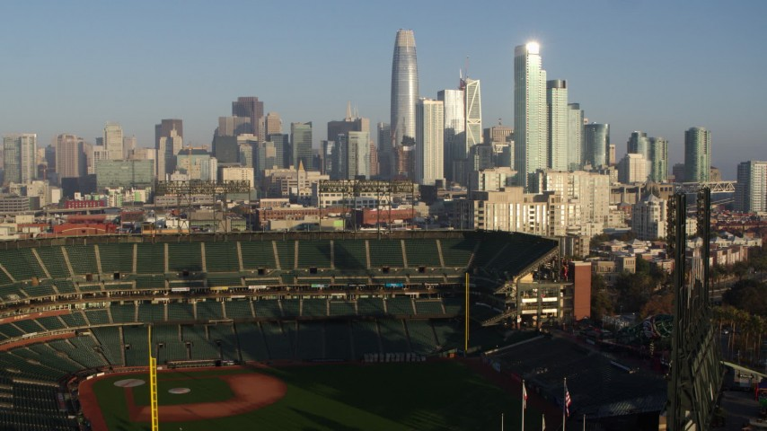 5.7K stock footage aerial video ascend from baseball stadium to focus on the skyline of Downtown San Francisco, California Aerial Stock Footage | PP0002_000083