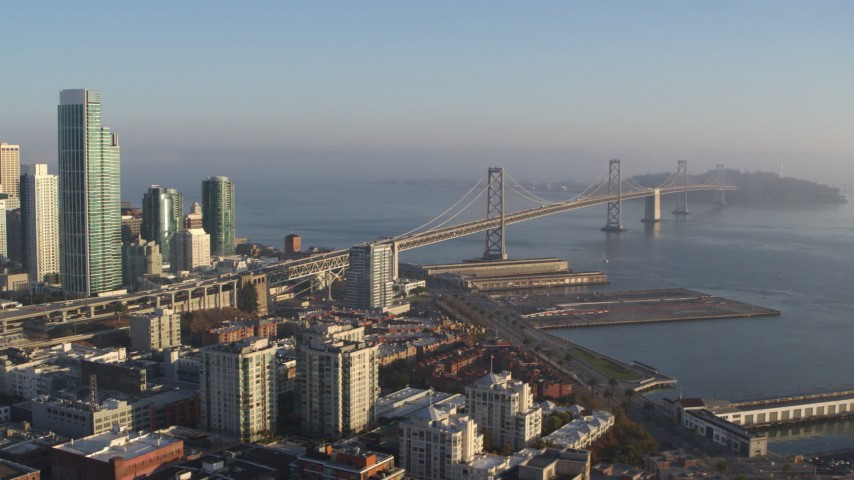 5.7K stock footage aerial video pan from the Bay Bridge to reveal skyline of Downtown San Francisco, California Aerial Stock Footage | PP0002_000087