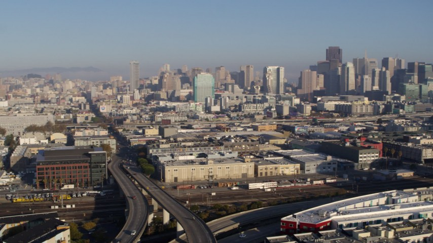 5.7K stock footage aerial video ascend by freeway and pan across city to reveal skyline, Downtown San Francisco, California Aerial Stock Footage | PP0002_000092