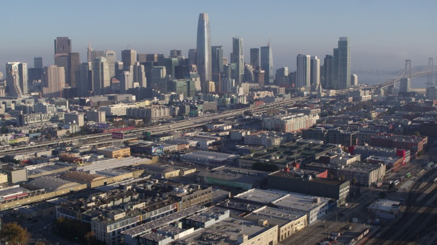 5.7K stock footage aerial video pan from South of Market train station and approach skyline, Downtown San Francisco, California Aerial Stock Footage | PP0002_000098