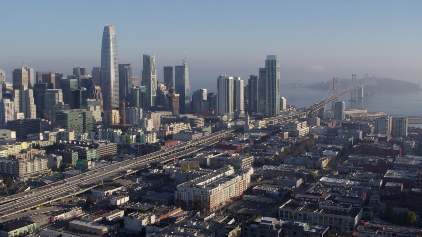 5.7K stock footage aerial video pan from I-80 in South of Market near city's skyline, reveal Bay Bridge, Downtown San Francisco, California Aerial Stock Footage | PP0002_000100