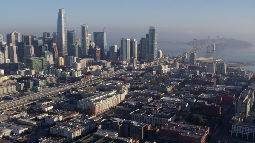 5.7K stock footage aerial video pan from I-80 freeway and Bay Bridge near skyline, reveal AT&T Park, Downtown San Francisco, California Aerial Stock Footage | PP0002_000104