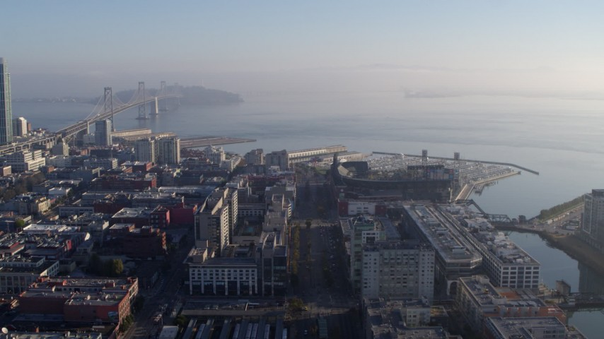5.7K stock footage aerial video pan from AT&T Park to reveal I-80 freeway and Bay Bridge near skyline, Downtown San Francisco, California Aerial Stock Footage PP0002_000105 | Axiom Images