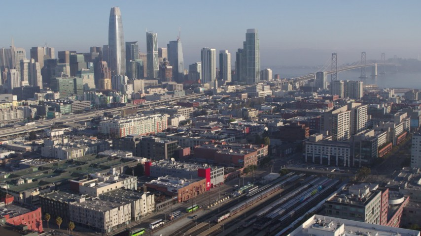 5.7K stock footage aerial video tilt from city skyline to reveal train station and condo complexes, Downtown San Francisco, California Aerial Stock Footage | PP0002_000106