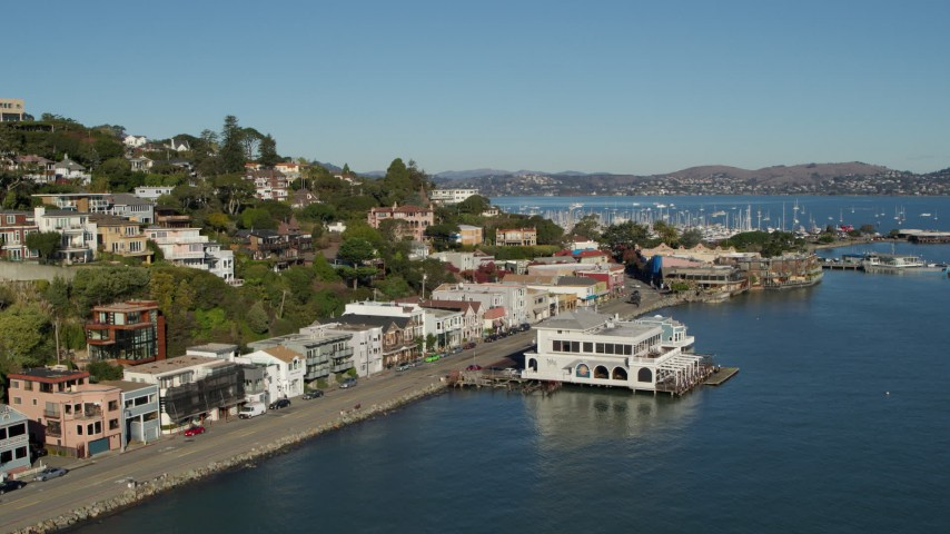5.7K stock footage aerial video of flying by waterfront homes on a hill with a view of Richardson Bay in Sausalito, California Aerial Stock Footage | PP0002_000123