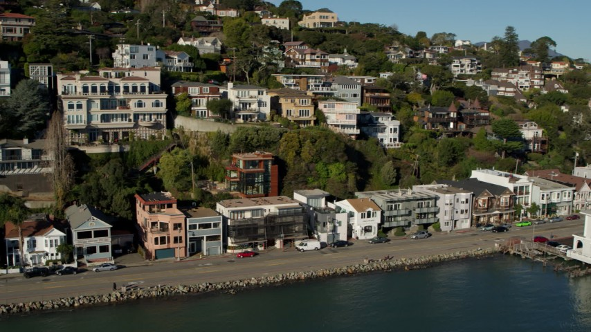 5.7K stock footage aerial video pan across waterfront homes on a hill with a view of Richardson Bay in Sausalito, California Aerial Stock Footage | PP0002_000124