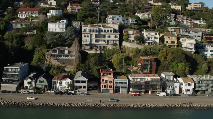 5.7K stock footage aerial video slowly pass waterfront homes on a hill by Richardson Bay in Sausalito, California Aerial Stock Footage | PP0002_000125