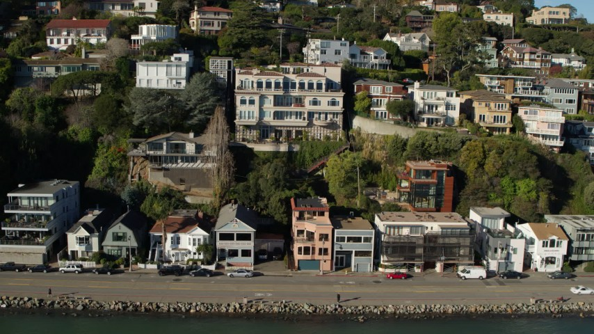 5.7K stock footage aerial video slowly flying by waterfront homes on a hill by Richardson Bay in Sausalito, California Aerial Stock Footage | PP0002_000126