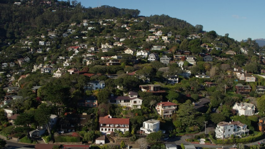 5.7K stock footage aerial video ascend past homes on a hill for a view of neighborhoods at the top in Sausalito, California Aerial Stock Footage | PP0002_000127