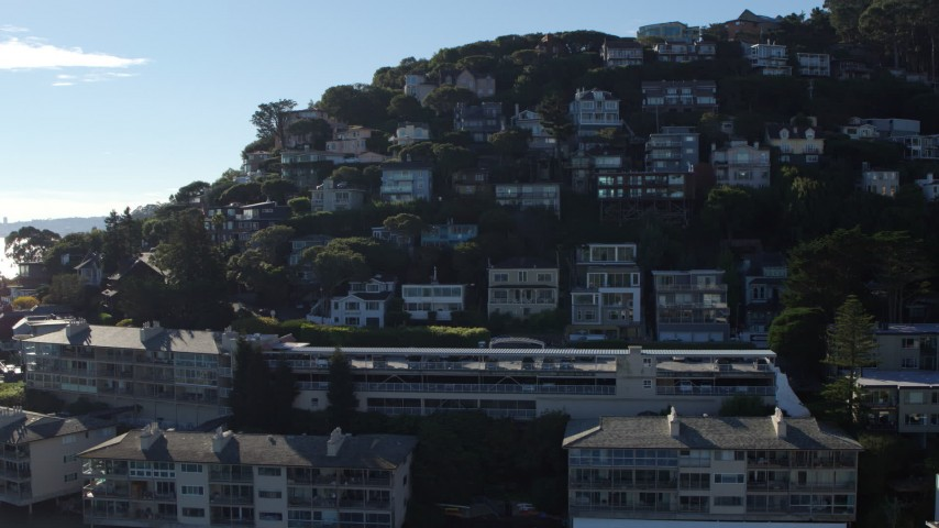 5.7K stock footage aerial video ascend by waterfront condos to a view hillside homes in Sausalito, California Aerial Stock Footage | PP0002_000131