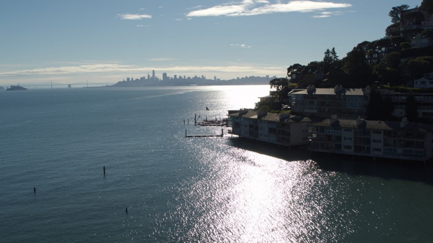 5.7K stock footage aerial video a view of the San Francisco skyline during decent, pan to condos in Sausalito, California Aerial Stock Footage | PP0002_000133