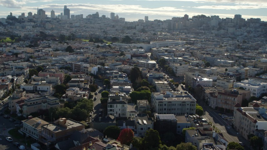 5.7K stock footage aerial video pan across Marina District apartment buildings, skyline in the background, San Francisco, California Aerial Stock Footage | PP0002_000140