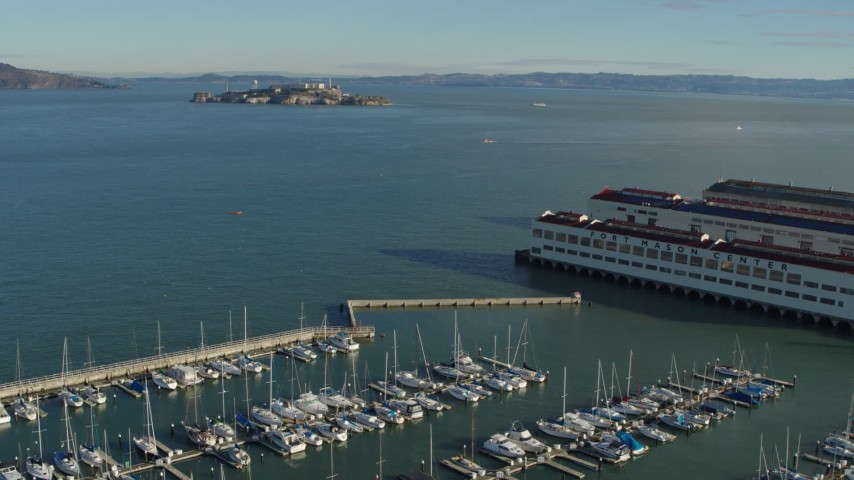 5.7K stock footage aerial video pan from Fort Mason piers to reveal Alcatraz, San Francisco, California Aerial Stock Footage | PP0002_000147
