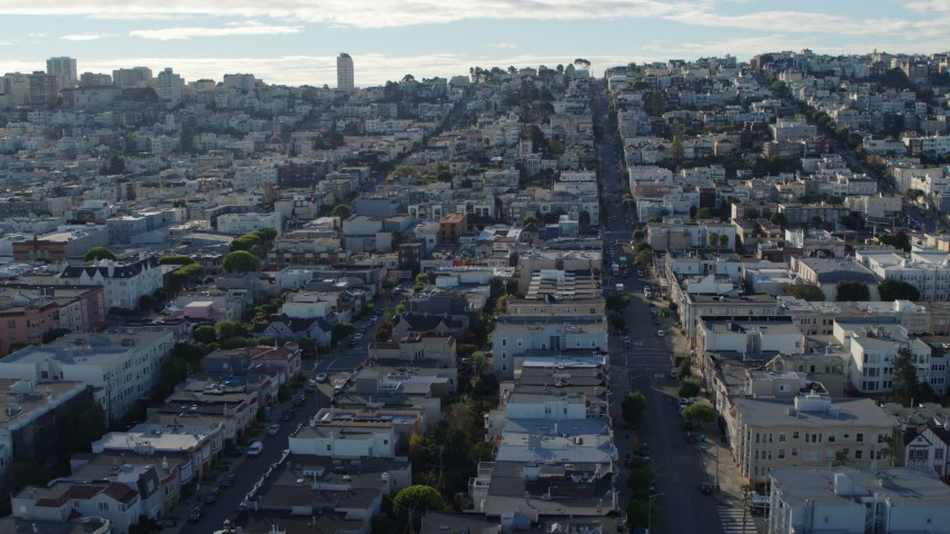 5.7K stock footage aerial video reverse view of quiet city street lined with apartment buildings in the Marina District, San Francisco, California Aerial Stock Footage | PP0002_000153