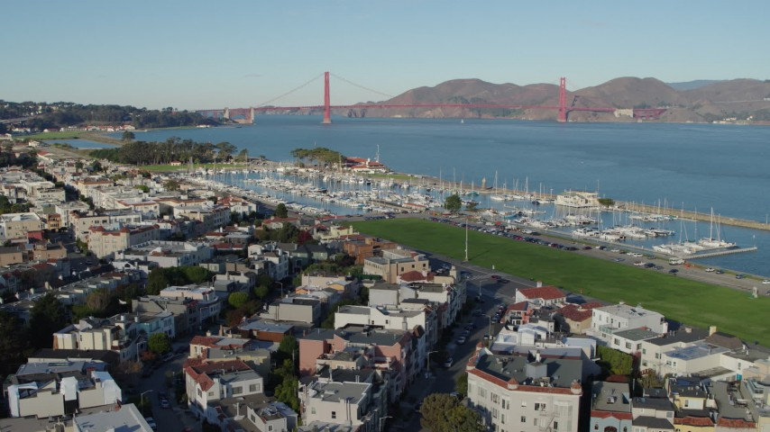 5.7K aerial video reverse view of Golden Gate Bridge and marina in the Marina District, San Francisco, California Aerial Stock Footage | PP0002_000156