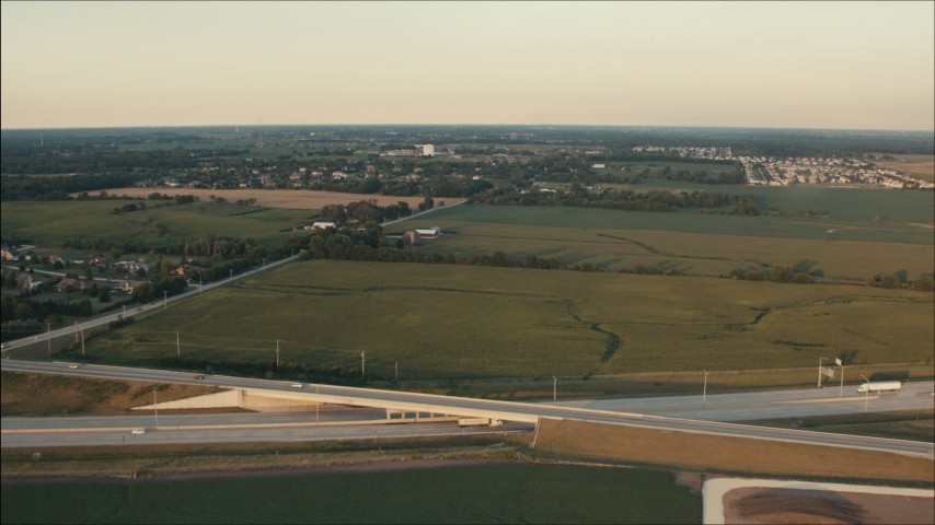 HD stock footage aerial video of flying over freeway and farm fields at sunset in Homer Glen, Illinois Aerial Stock Footage | PP001_006