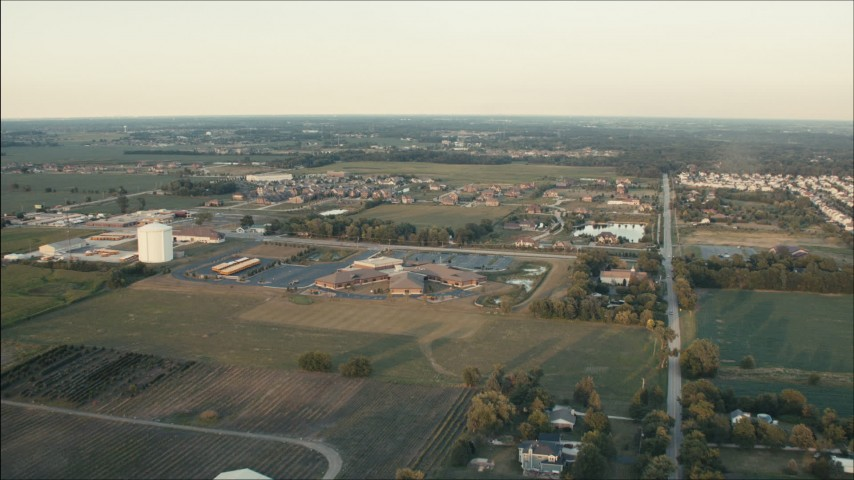 HD stock footage aerial video of approaching a school near rural neighborhoods at sunset in Homer Glen, Illinois Aerial Stock Footage PP001_007 | Axiom Images