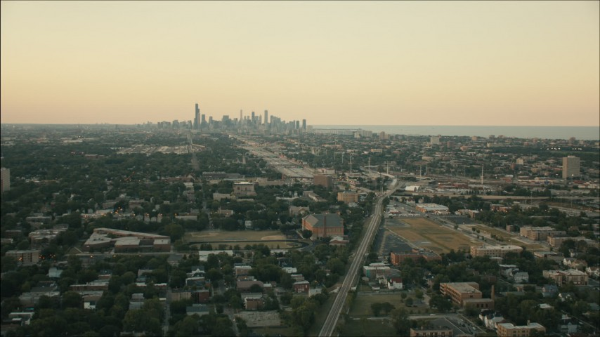 HD stock footage aerial video of the Downtown Chicago skyline at sunset seen from Englewood, Illinois Aerial Stock Footage | PP001_017