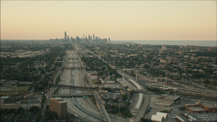 HD stock footage aerial video of the city skyline seen from the interstate at sunset, Downtown Chicago, Illinois Aerial Stock Footage | PP001_018