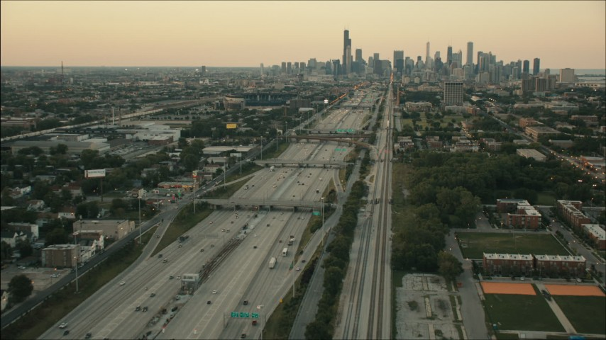 HD stock footage aerial video of following freeway and train tracks at sunset to approach Downtown Chicago, Illinois Aerial Stock Footage | PP001_022
