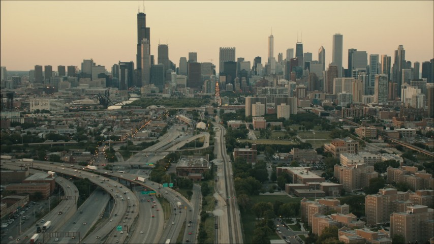 HD stock footage aerial video of tilting from train tracks to reveal the skyline at sunset, Downtown Chicago, Illinois Aerial Stock Footage | PP001_024