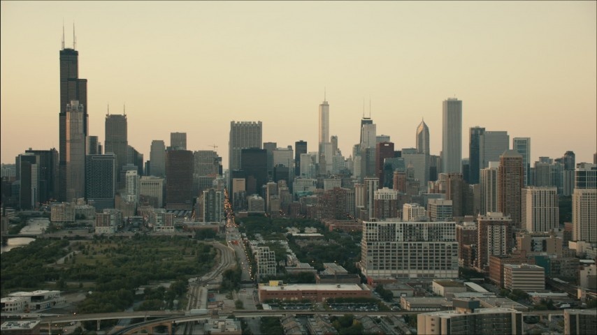 HD stock footage aerial video tilt from freeway interchange to reveal the skyline at sunset, Downtown Chicago, Illinois Aerial Stock Footage | PP001_025