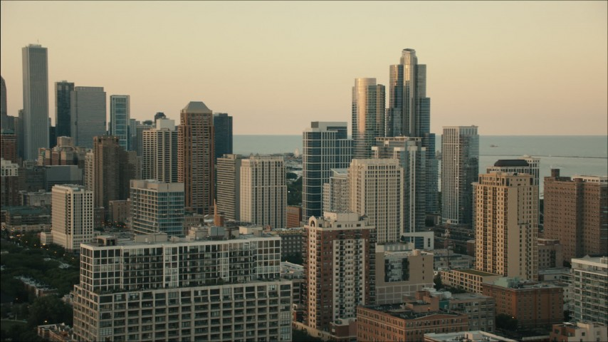 HD stock footage aerial video of flying by city skyscrapers at sunset in Downtown Chicago, Illinois Aerial Stock Footage | PP001_026