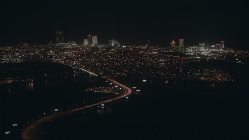 HD aerial video of flying toward hotels and casinos in Atlantic City, New Jersey at night Aerial Stock Footage   PP003_006